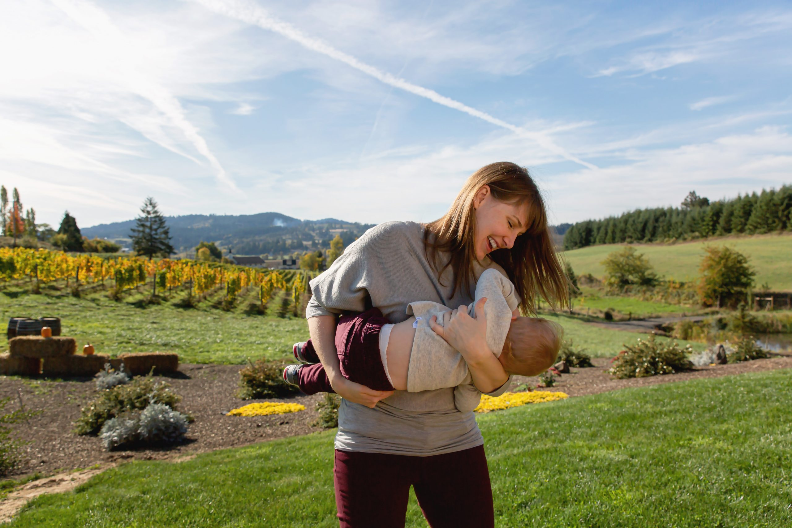 Mama with baby boy at Domaine Divio winery with Photographer Annie Helen