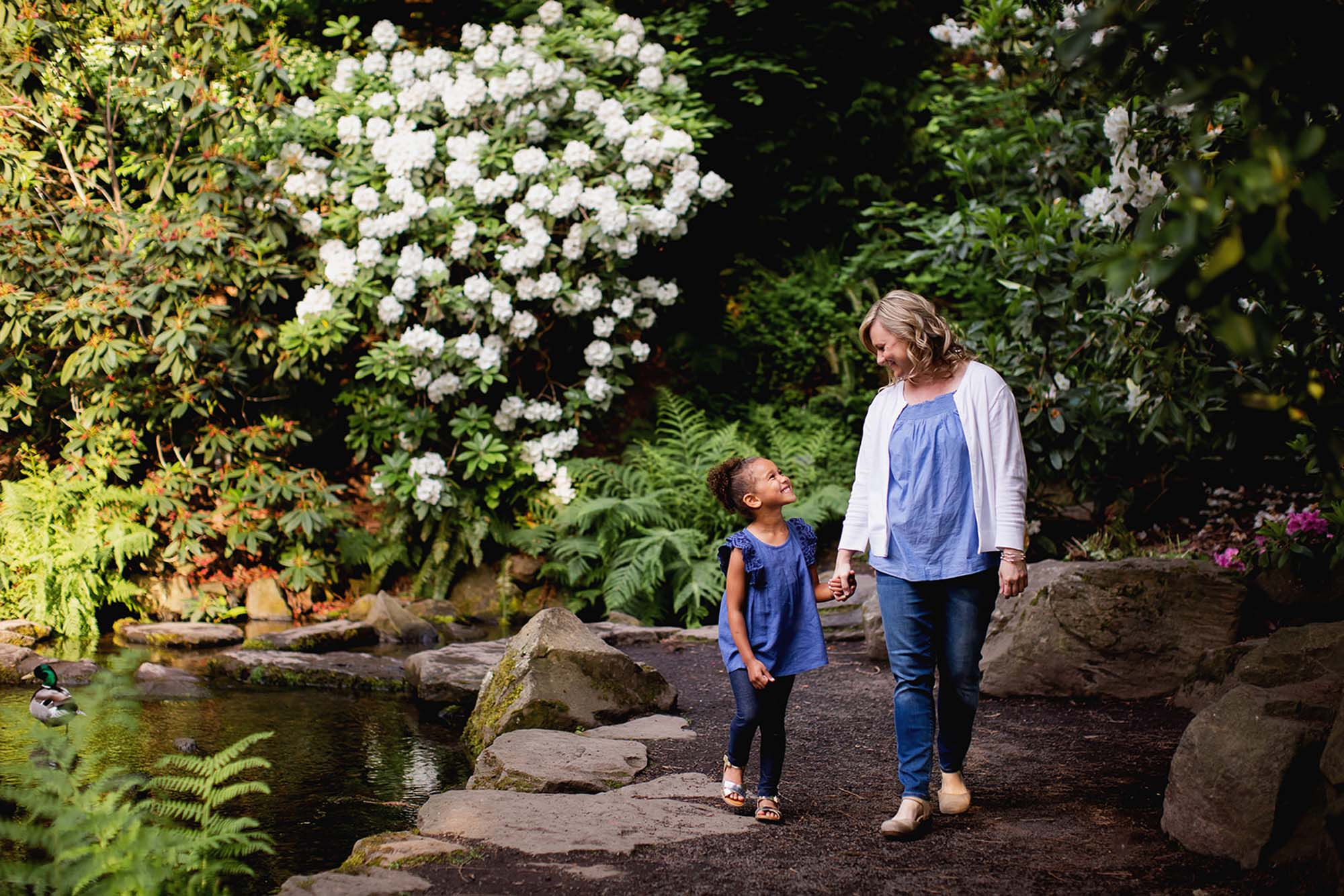 Mom and daughter walking in Crystal Springs Rhododendron Garden