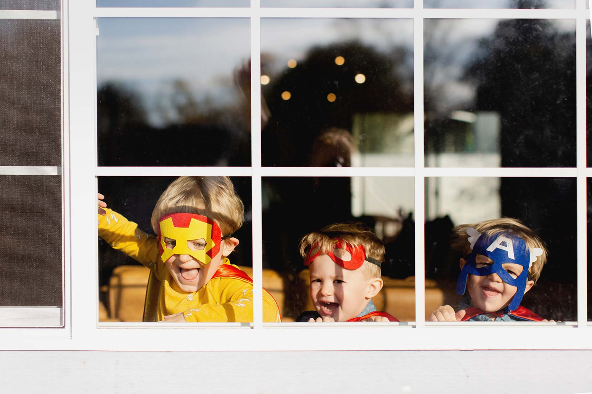 Boys dressed as superheros Staying inside Family Photo Session