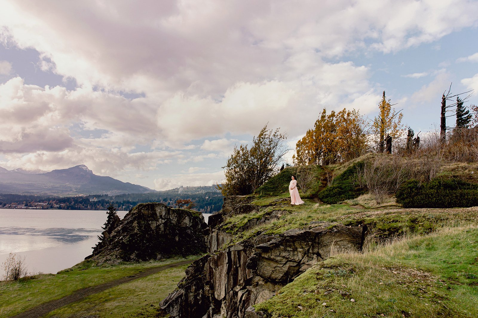 Woman on cliffside at Columbia River Gorge Maternity Photo Session with Oregon Adventure Photographer Annie Helen
