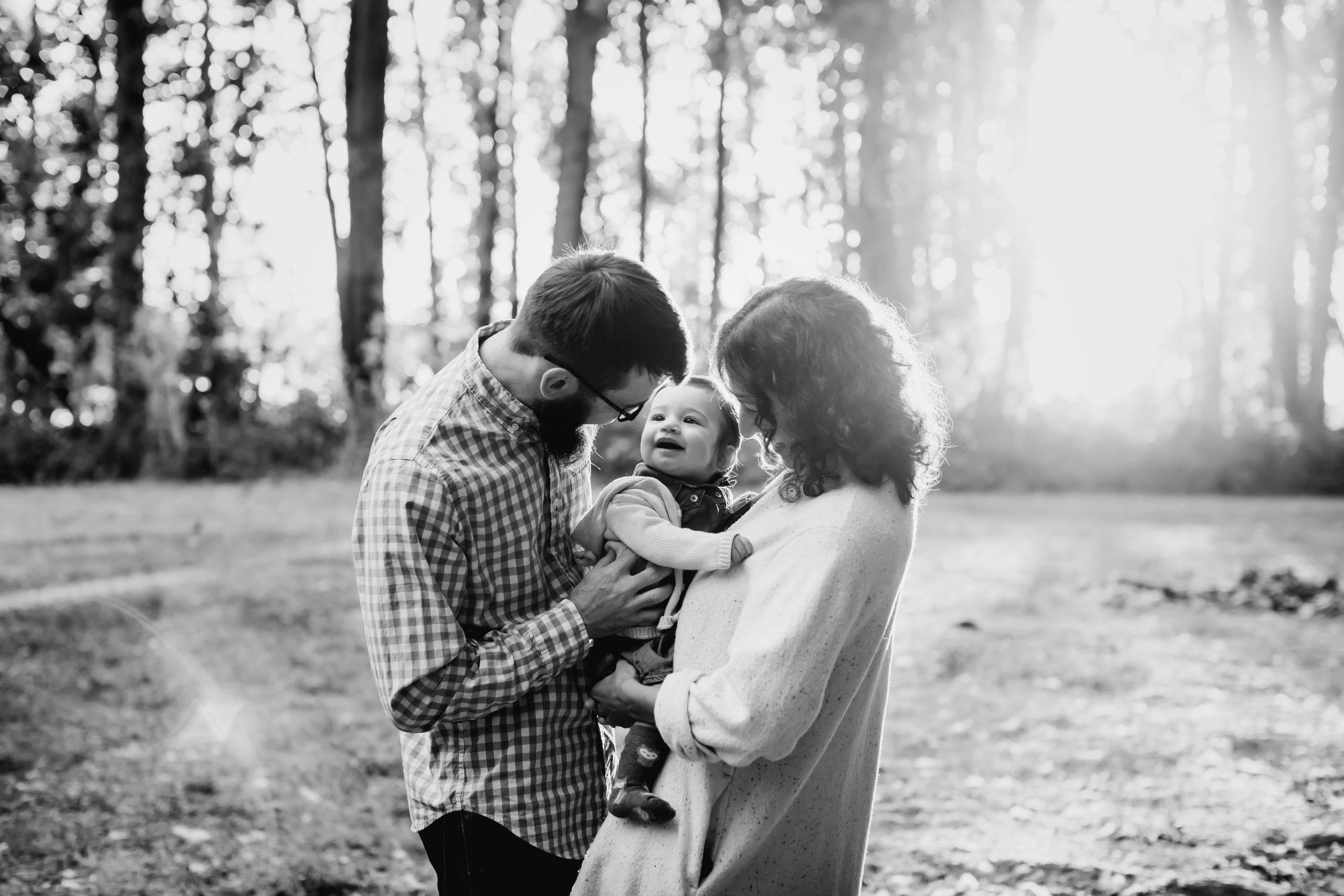 BW photo of young family in park at sunrise